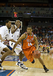 Virginia guard Sean Singletary (44) dribbles past Georgia Tech forward/center Alade Aminu (44).  The Virginia Cavaliers fell to the Georgia Tech Yellow Jackets 94-76  in the first round of the 2008 ACC Men's Basketball Tournament at the Charlotte Bobcats Arena in Charlotte, NC on March 13, 2008.