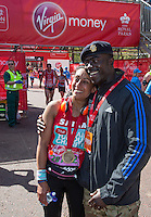 Businesswoman and TV presenter Saira Khan (ex The Apprentice) gets a hug from a soldier at the end of the Virgin Money London Marathon 2014 on Sunday 13 April 2014<br /> Photo: Roger Allan/Virgin Money London Marathon<br /> media@london-marathon.co.uk