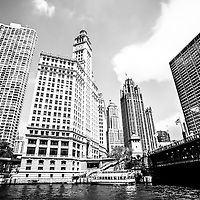 Downtown Chicago buildings black and white picture. Photo includes Michigan Avenue Bridge (DuSable Bridge), the Chicago River, Wrigley Building, Tribune Tower, and The Equitable Building.