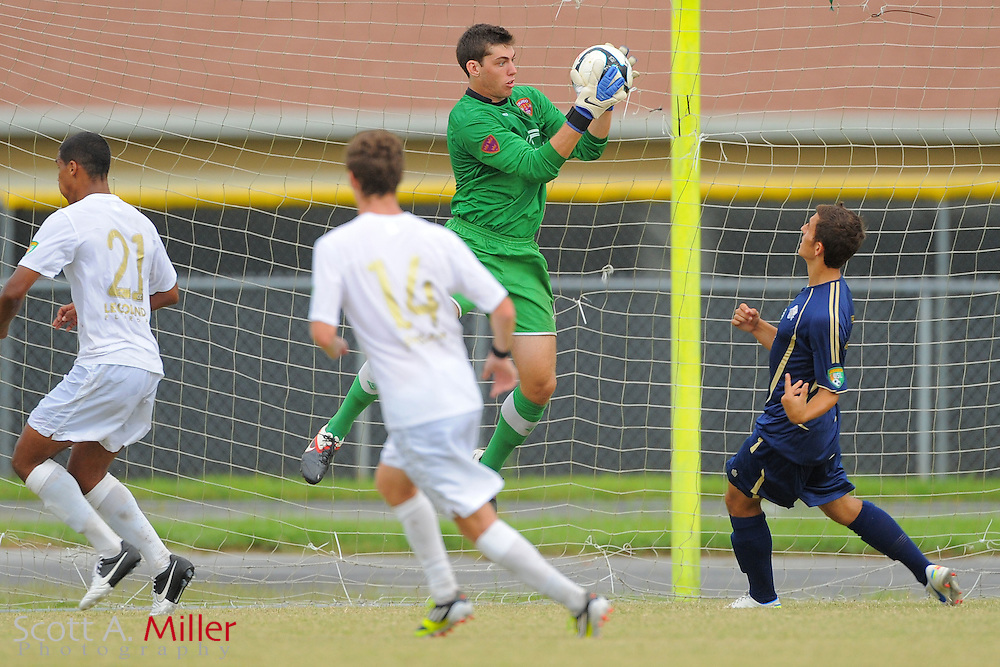 Orlando City goalkeeper Brendan Moore (1) goes airborne for a ball during City's win 4-1 over the Austin Aztex in the PDL Southern Conference Championships final at Trinity Catholic High Schooll on July 22, 2012 in Ocala, Florida. ..©2012 Scott A. Miller