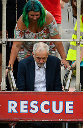 "© Licensed to London News Pictures. 27/06/2016. London, UK. Labour Party leader JEREMY CORBYN climbs down from a fire engine after addressing a ""Keep Corbyn"" Momentum demonstration outside the Houses of Parliament in london. The majority of the Labour shadow cabinet resigned today (Mon) in protest at Corbyn's leadership. Photo credit: Ben Cawthra/LNP"