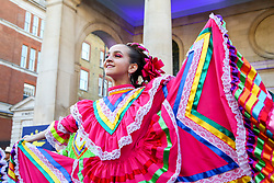 © Licensed to London News Pictures. 30/12/2019. London, UK. A performer from Carnaval del Pueble performs at the preview of the London New Year's Day Parade in Covent Garden Piazza.<br /> The London New Years Day Parade, in its 32nd year will take place on 1 January 2020 and will feature more than 10,000 performers from across the world. Photo credit: Dinendra Haria/LNP
