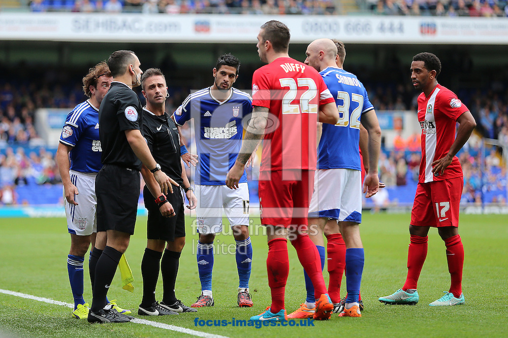 Referee, James Adcock consults his assistant, Wade Norcott during the Sky Bet Championship match between Ipswich Town and Blackburn Rovers at Portman Road, Ipswich<br /> Picture by Richard Calver/Focus Images Ltd +447792 981244<br /> 18/10/2014