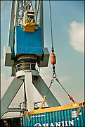 A crane lifts a container in the Rotterdam Harbor on 10 April, 2008 in Rotterdam, The Netherlands. (photo by Michel de Groot)