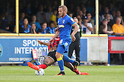 AFC Wimbledon midfielder Dean Parrett (18) tackled by Shrewsbury Town FC forward Ivan Toney during the EFL Sky Bet League 1 match between AFC Wimbledon and Shrewsbury Town at the Cherry Red Records Stadium, Kingston, England on 24 September 2016. Photo by Stuart Butcher.