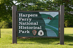 National Park Service (NPS) welcome sign at the entrance to Harpers Ferry National Historical Park, Harpers Ferry, West Virginia.  .Harpers Ferry National Historical Park is located at the confluence of the Potomac and Shenandoah rivers in and around Harpers Ferry, West Virginia. The park includes land in the adjacent states of Maryland and Virginia. The park is managed by the National Park Service, an agency of the U.S. Department of the Interior. Originally designated a National Monument in 1944, the park was declared a National Historical Park by the U.S. Congress in 1963. The park includes the historic town of Harpers Ferry, notable as a center of 19th century industry and as the scene of John Brown's abolitionist uprising. The park was listed on the National Register of Historic Places on October 15, 1966.