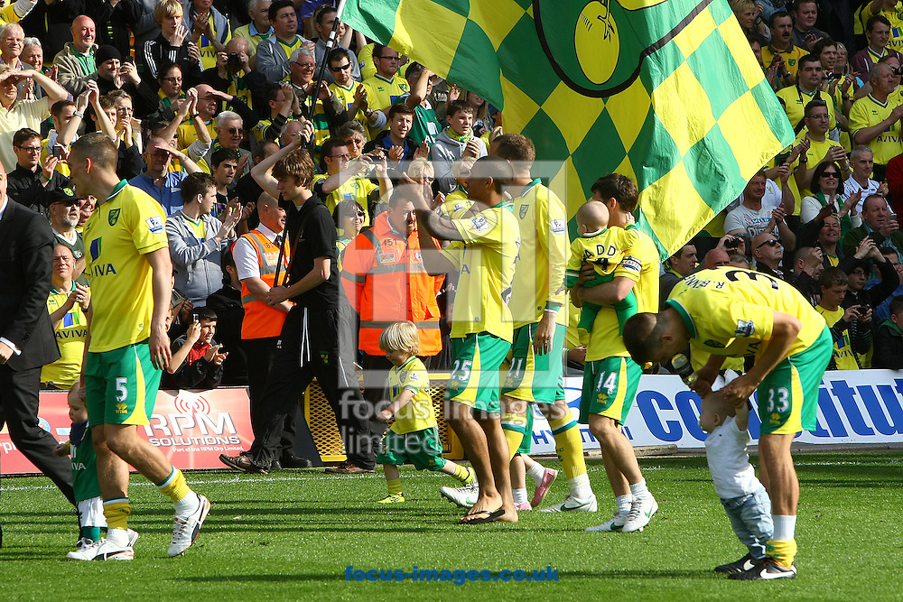 Picture by Paul Chesterton/Focus Images Ltd.  07904 640267.13/05/12.The Norwich players on the lap of appreciation after the Barclays Premier League match at Carrow Road Stadium, Norwich.