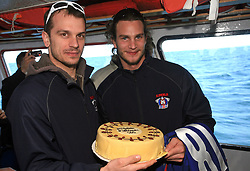 Jurij Golicic and Gregor Poloncic with a cake at whale watching boat when Poloncic (18), Golicic (17), Rebolj (27) and Razingar (9) were celebrating an anniversary of playing for Slovenian National Team for 100 (120) times, during IIHF WC 2008 in Halifax,  on May 07, 2008, sea at Halifax, Nova Scotia,Canada.(Photo by Vid Ponikvar / Sportal Images)