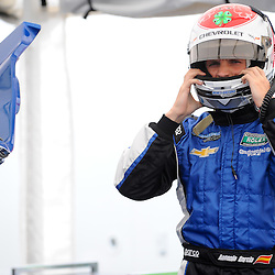 June 30, 2012 - Spirit of Daytona driver Antonio Garcia pulls on his helmet before qualifying for The Grand-Am Rolex Sports Car Series Sahlen's Six Hours of the Glen.