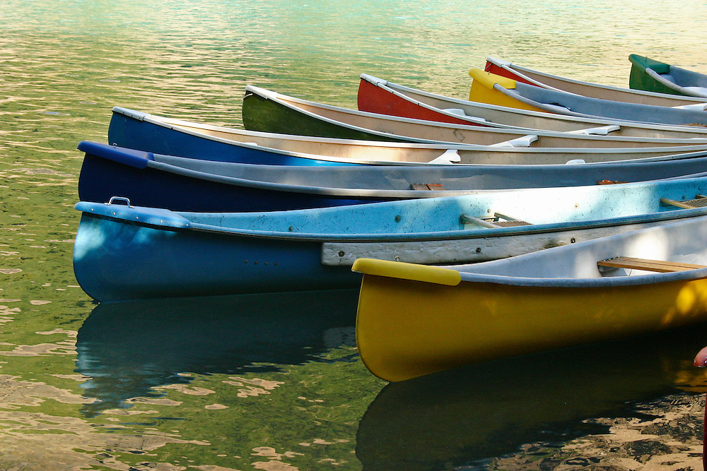 Group of canoes lie at rest near Lake Louise Alberta