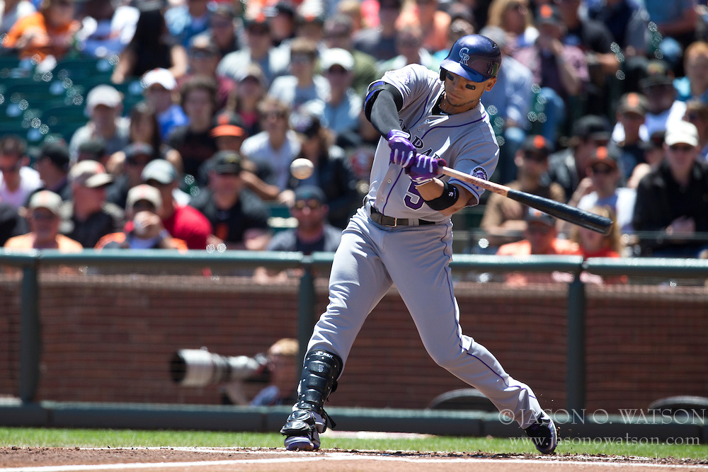 SAN FRANCISCO, CA - MAY 26: Carlos Gonzalez #5 of the Colorado Rockies at bat against the San Francisco Giants during the first inning at AT&T Park on May 26, 2013 in San Francisco, California. The San Francisco Giants defeated the Colorado Rockies 7-3. (Photo by Jason O. Watson/Getty Images) *** Local Caption *** Carlos Gonzalez