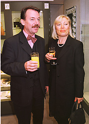 MR & MRS ERIC KNOWLES he is the antique expert, at a party in London on 22nd April 1998.MGX 33