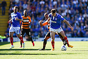 Portsmouth's  Enda Stevens holds off Barnet's Mauro Vilhete during the Sky Bet League 2 match between Portsmouth and Barnet at Fratton Park, Portsmouth, England on 12 September 2015. Photo by David Charbit.