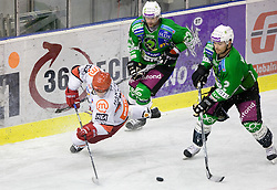 Marjan Manfreda of Acroni Jesenice vs Ivo Jan and Kevin Mitchell of Tilia Olimpija at 38th Round of EBEL league  ice hockey match between HDD Tilia Olimpija Ljubljana and HK Acroni Jesenice, on January 1, 2010, in Arena Tivoli, Ljubljana, Slovenia. (Photo by Vid Ponikvar / Sportida)