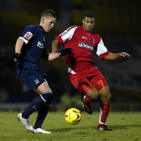 Photo: Chris Ratcliffe.<br /> Southend United v Swindon Town. Coca Cola League 1. 27/01/2006.<br /> Freddy Eastwood (L) of Southend and <br /> Jerel Ifil of windon tussle for the ball