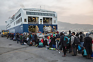Refugees enter a ferry to Athens