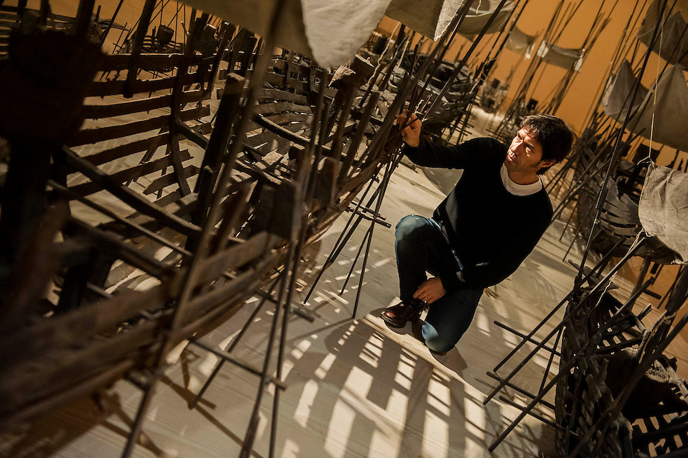 """Departure, the first UK solo exhibition of artist Xavier Mascaró (pictured). Highlights include: Departure (pictured) an installation of boats made from bronze and iron """"which are evocative of long-forgotten shipwrecks""""; iron portraits of a young woman from the Eleonora series """"reminiscent of the profiles on ancient coins""""; delicate metal works """"resembling votive figures from his Idols series""""; and his Guardians series, of 10 feet high rusted iron warriors """"inspired by medieval armour and ancient Egyptian and Greek art"""".  The latter being the first outdoor installation by the Gallery since moving to Chelsea. The show runs from 3 September until 5th October at The Saatchi Gallery, Chelsea, London. 01 September 2014."""