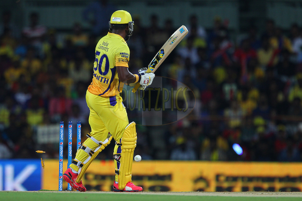 Dwayne Smith of the Chennai Superkings looks at his wicket as the bails fall during match 24 of the Pepsi IPL 2015 (Indian Premier League) between The Chennai Superkings and The Kings XI Punjab held at the M. A. Chidambaram Stadium, Chennai Stadium in Chennai, India on the 25th April 2015.<br /> <br /> Photo by:  Ron Gaunt / SPORTZPICS / IPL