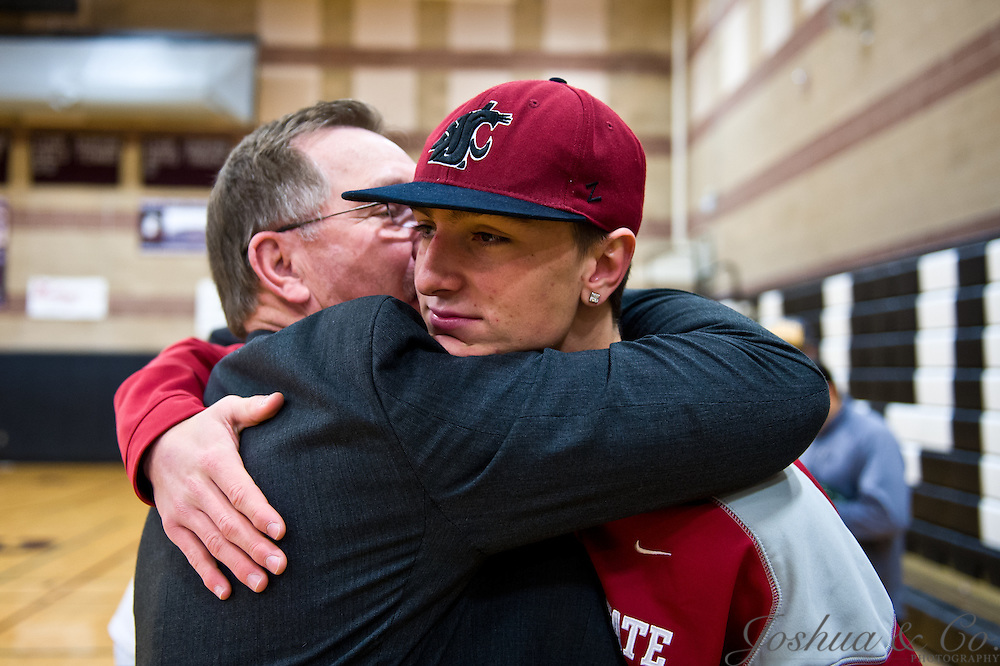 Austin Apodaca signs his national letter of intent to play football for Washington State University with family on hand to celebrate on Wednesday, Feb. 1, 2012 at Silver Creek High School in Longmont, Colo...Photo by Joshua Lawton // www.joshuacophotography.com