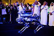 Riyadh, Saudi Arabia – October 25, 2017: Participants watch a demonstration of a robotic dog at the Future Investment Initiative conference. The proposed new Saudi city NEOM, would prominently feature smart robots. <br /> <br /> Credit: Tasneem Alsultan for The New York Times