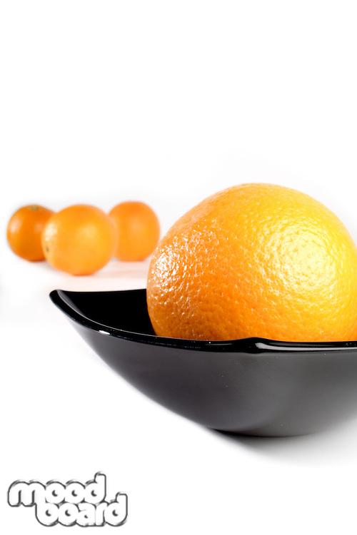 Studio shot of orange in bowl