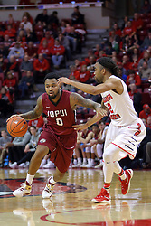 26 November 2016:  Darell Combs looks for a way past Tony Wills(12) during an NCAA  mens basketball game between the IUPUI Jaguars the Illinois State Redbirds in a non-conference game at Redbird Arena, Normal IL