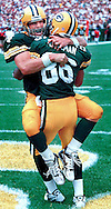 (1998)-Green Bay Quarterback Brett Favre celebrates with Antonio Freeman, after Freeman caught a 84-yard td pass in the fourth quarter against the Detroit Lions.