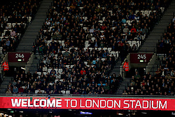 West Ham United fans in the stands above a 'Welcome To London Stadium' sign