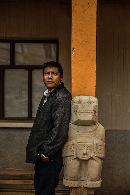 """TIWANAKU, BOLIVIA - December 16, 2013: Newly appointed director of Tiwanaku archaeological site and museums, Ludwing Cayo, poses for a portrait. Tiwanaku is the most important archaeological site in Bolivia and is often referred to as """"the Stonehenge of the Americas"""". It is also a UNESCO world heritage site. Politicians and archaeologists have feuded over the care of the site for several years. As the result of mismanagement and funding disputes, only one museum is currently open to the public. Mr. Cayo was assigned to Tiwanaku with the  charge of getting the other museums in shape to re-open them in 2014.   CREDIT: Meridith Kohut for The New York Times"""