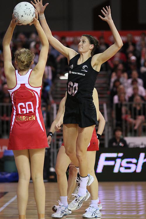 New Zealand's Anna Scarlett defends England's Jo Harten's shot at goal  in the New World International Netball match, ILT Velodrome, Invercargill, New Zealand, Thursday, October 06, 2011. Credit:SNPA / Dianne Manson.