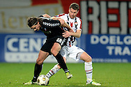 Onderwerp/Subject: Willem II - FC Utrecht - Eredivisie<br /> Reklame:  <br /> Club/Team/Country: <br /> Seizoen/Season: 2012/2013<br /> FOTO/PHOTO: Marc HOCHER (R) of Willem II in duel with Dave BULTHUIS (L) of FC Utrecht. (Photo by PICS UNITED)<br /> <br /> Trefwoorden/Keywords: <br /> #04 #17 $94 &plusmn;1342772348418<br /> Photo- &amp; Copyrights &copy; PICS UNITED <br /> P.O. Box 7164 - 5605 BE  EINDHOVEN (THE NETHERLANDS) <br /> Phone +31 (0)40 296 28 00 <br /> Fax +31 (0) 40 248 47 43 <br /> http://www.pics-united.com <br /> e-mail : sales@pics-united.com (If you would like to raise any issues regarding any aspects of products / service of PICS UNITED) or <br /> e-mail : sales@pics-united.com   <br /> <br /> ATTENTIE: <br /> Publicatie ook bij aanbieding door derden is slechts toegestaan na verkregen toestemming van Pics United. <br /> VOLLEDIGE NAAMSVERMELDING IS VERPLICHT! (&copy; PICS UNITED/Naam Fotograaf, zie veld 4 van de bestandsinfo 'credits') <br /> ATTENTION:  <br /> &copy; Pics United. Reproduction/publication of this photo by any parties is only permitted after authorisation is sought and obtained from  PICS UNITED- THE NETHERLANDS