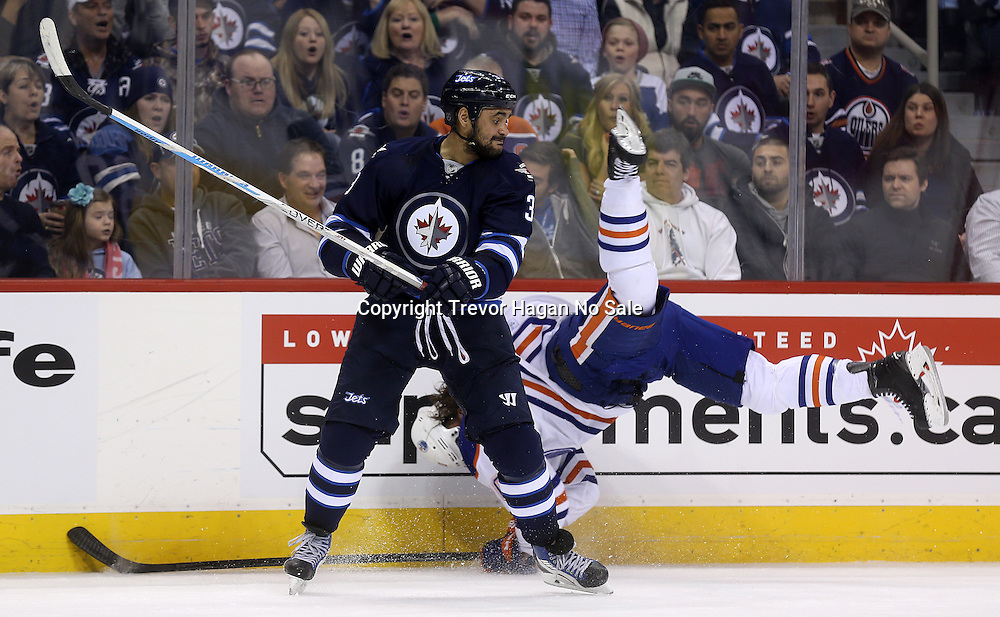 Image not for sale. Winnipeg Jets' Dustin Byfuglien (33) hits Edmonton Oilers' Luke Gazdic (20) during second period NHL hockey action in Winnipeg, Monday, February 16, 2015.