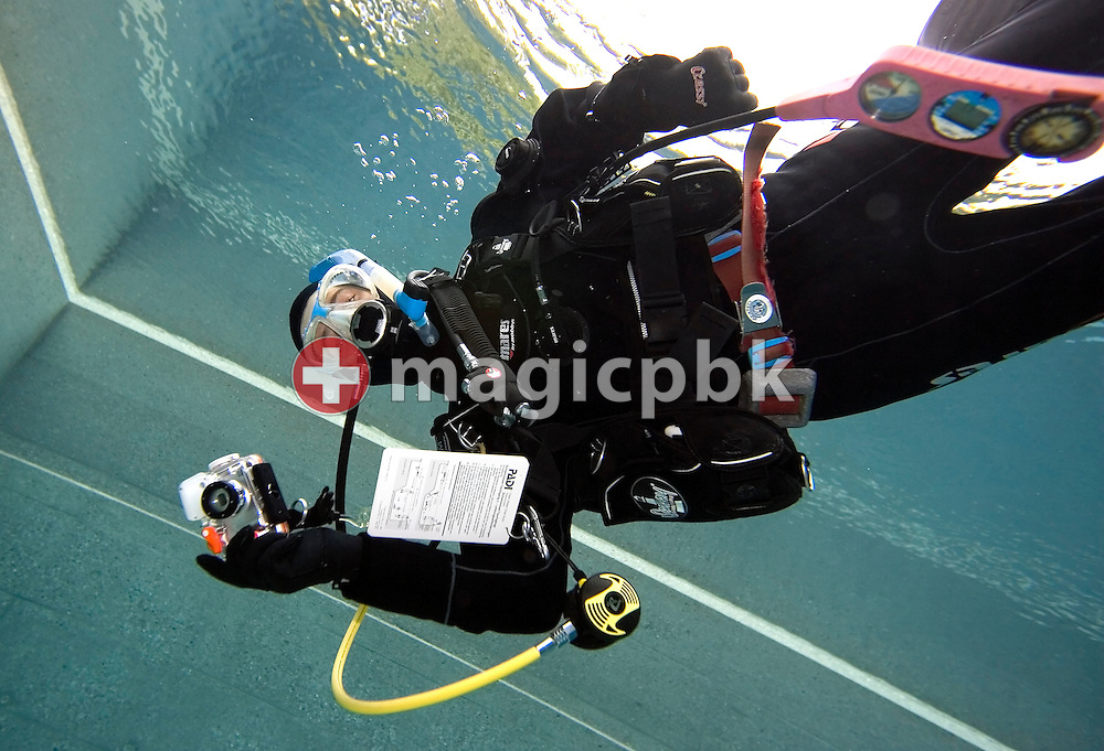 Diving instructor Madeleine Jung is pictured during a PADI scuba diving training lesson in the outdoor pool in Gossau, ZH, Switzerland, Monday, May 26, 2008. (Photo by Patrick B. Kraemer / MAGICPBK)