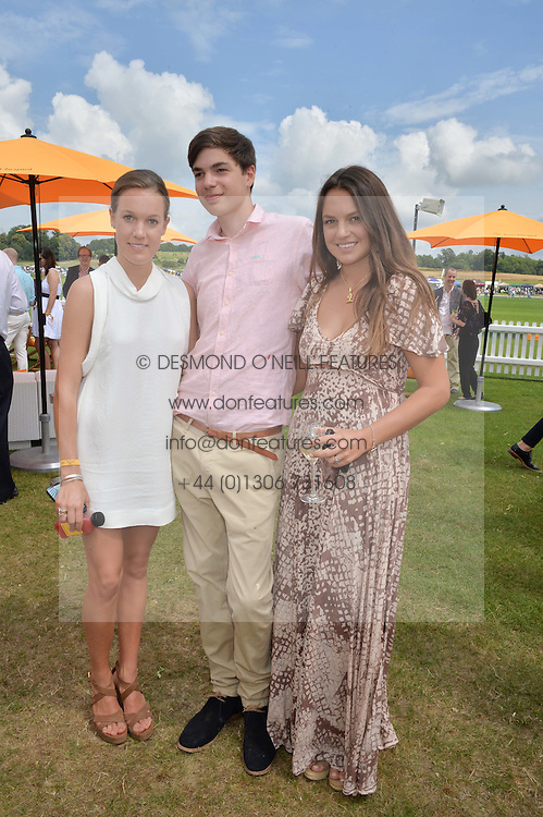 Left to right, the HON.EMILY PEARSON, the HON.MONTY PERASON and the HON.CATRINA PEARSON children of Viscount Cowdray at the Veuve Clicquot Gold Cup Final at Cowdray Park Polo Club, Midhurst, West Sussex on 20th July 2014.