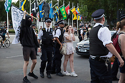 London, UK. 24 July, 2019. Police officers try to move protesters from antifascist and LGBT+ groups out of the road in Parliament Square during a protest against Boris Johnson's appointment as Prime Minister following his election as leader of the Conservative Party by its members. The protest was named after a lyric in a song by rapper Stormzy recently sung by thousands of festival goers at Glastonbury. Credit: Mark Kerrison/Alamy Live News