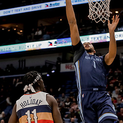 Jan 7, 2019; New Orleans, LA, USA; Memphis Grizzlies forward Kyle Anderson (1) shoots over New Orleans Pelicans guard Jrue Holiday (11) during the first quarter at the Smoothie King Center. Mandatory Credit: Derick E. Hingle-USA TODAY Sports