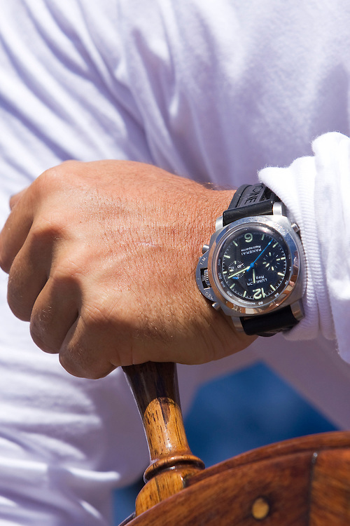 Driving the boat with a watch on the wrist during the 2008 Antigua Classic Yacht Regatta . This race is one of the worlds most prestigious traditional yacht races. It takes place annually off the cost of Antigua in the British West Indies. Antigua is a yachting haven, historically a british navy base in the times of Nelson.