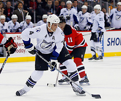 March 7, 2008; Newark, NJ, USA; Tampa Bay Lightning center Vincent Lecavalier (4) takes a shot during the first period at the Prudential Center in Newark, NJ.