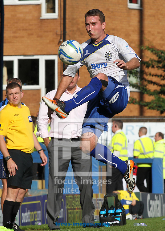 Picture by Michael Sedgwick/Focus Images Ltd +44 7900 363072.08/09/2012.Peter Sweeney of Bury in action against Preston North End during the npower League 1 match at Gigg Lane, Bury.