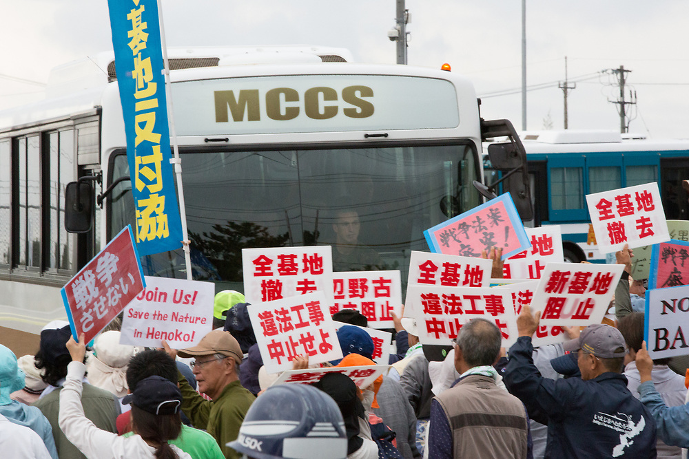 OKINAWA, JAPAN - NOVEMBER 14:  Anti U.S. Base protesters shout with their placards while blocking US marines in front of the gate of U.S Marine Base in Camp Schwab, protesting against the construction of the new U.S base in Henoko, Nago, Okinawa prefecture, Japan on November 14, 2015. (Photo: Richard Atrero de Guzman)