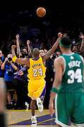 A jubulant Kobe Bryant runs down the floor after an outlet pass in the final seconds of the game. The Lakers defeated the Boston Celtics in game 7 of the NBA Finals  83-79 in Los Angeles, CA 06/16/2010 (John McCoy/Staff Photographer)