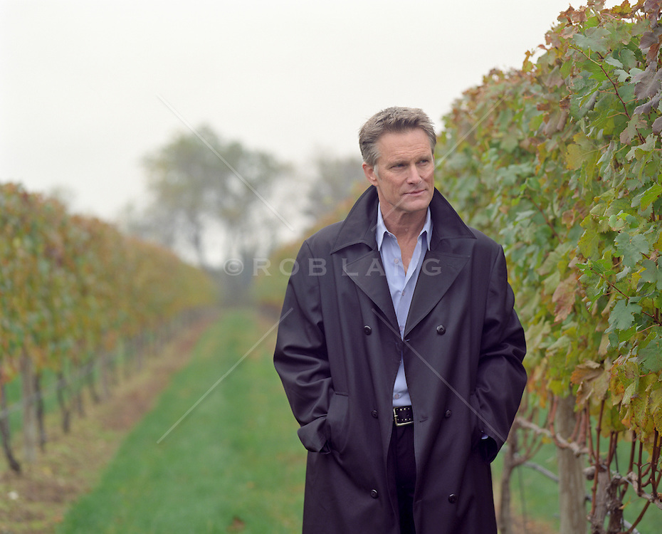man walking in a vineyard in The Hamptons