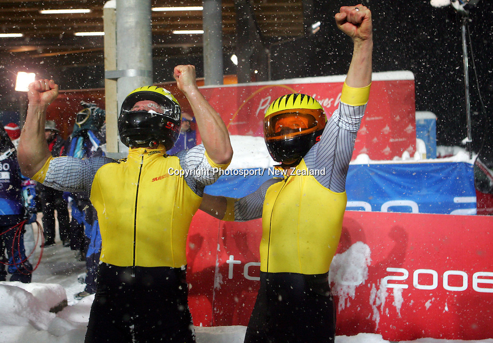 Swiss  bronze medalists Beat Hefti, left, and  Martin Annen show their excitement at gaining a medal in  the final  of the two man bobsleigh held at Cesana Pariol  during the 2006 Winter Olympic Games held in Torino, Italy.     19/02/06  PHOTO: PETER MEECHAM/PHOTOSPORT