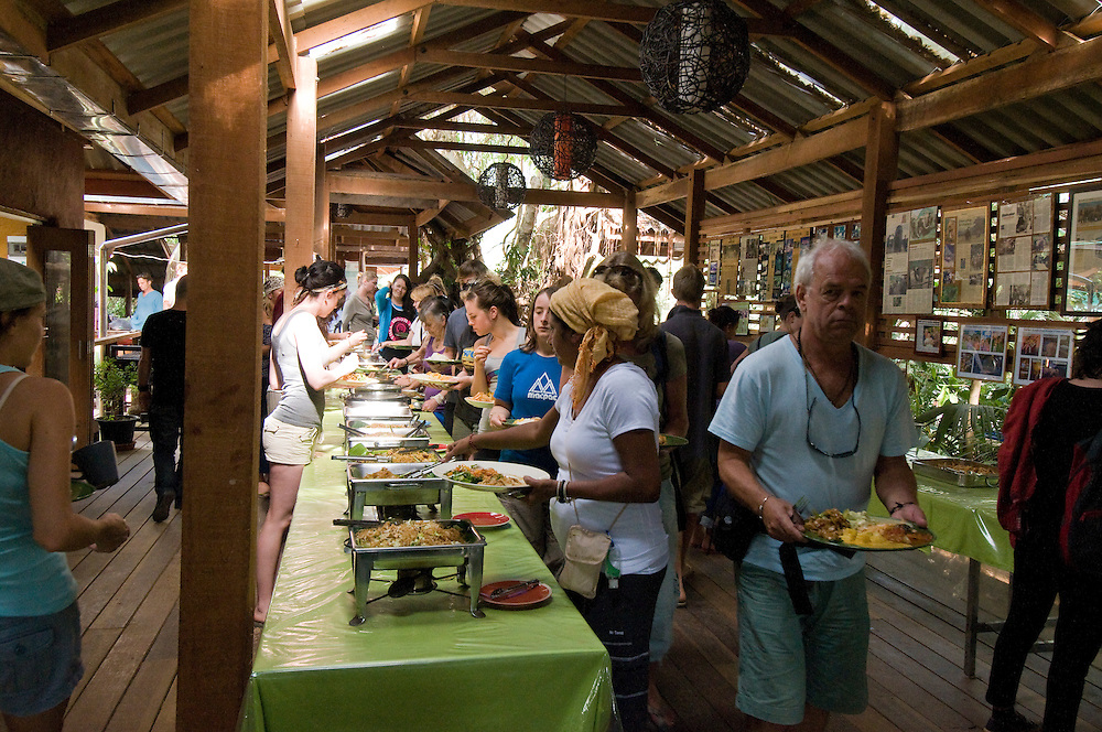 "Tourists and volunteers take a break for lunch at the Elephant Nature Park near Chiang Mai, Thailand.  Sangduen ""Lek"" Chailert founded the park as a sanctuary and rescue centre for elephants.  The park currently has 32 elephants sponsored and supported by volunteers from all over the world."