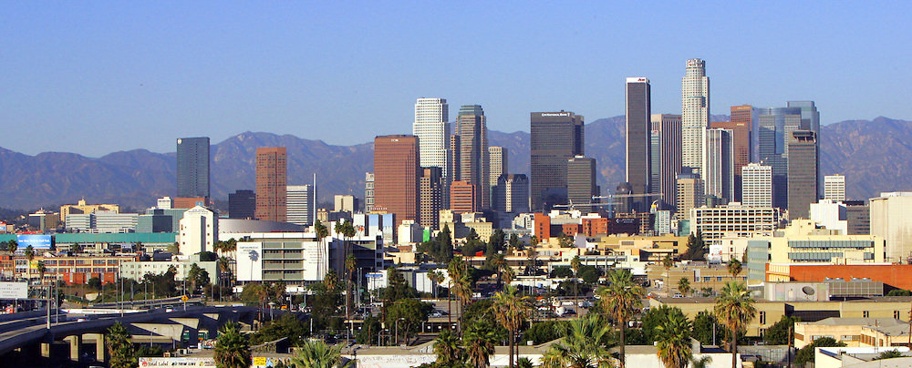 13 October 2005: View of the downtown Los Angeles Skyline during a sunny afternoon on a day of santa ana winds that cleared the skies to see the hills behind the city and tall buildings in the downtown area. 110 Freeway, Convention Center and Staples Center on the left side of the frame.