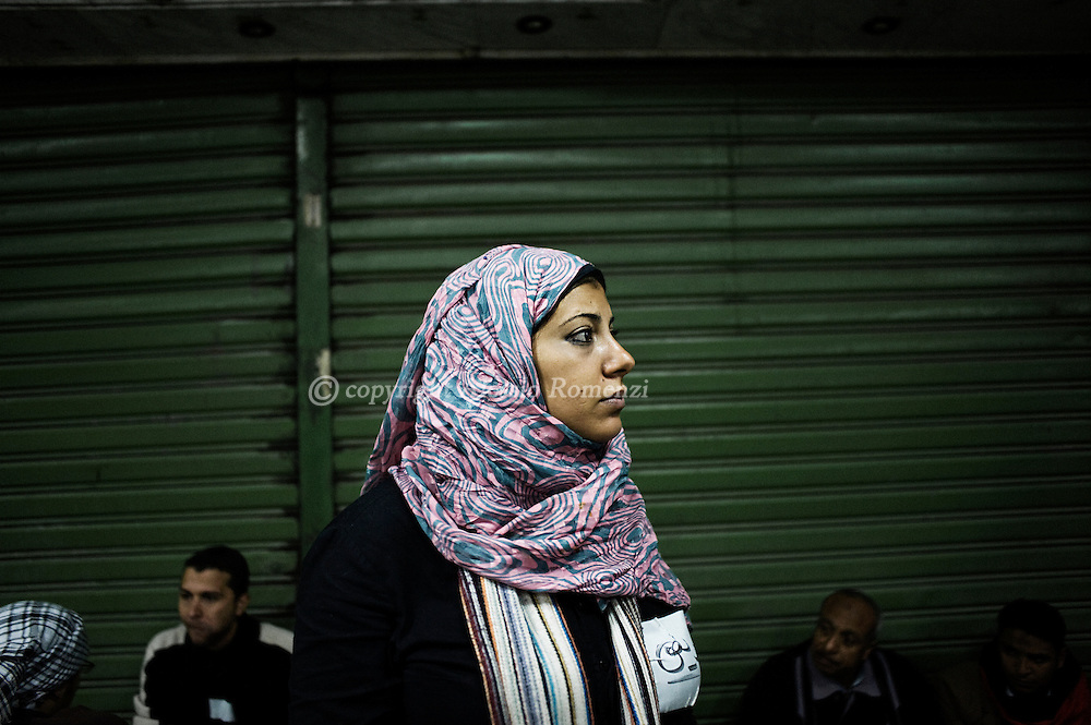 A woman stands in a mosque near Tahrir square (became an emergency repart) in Cairo on February 2, 2010.© ALESSIO ROMENZI