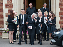 © Licensed to London News Pictures. 25/08/2015. London, UK. Friends and relatives attend the funeral of Stephen Lewis, who played Inspector Cyril 'Blakey' in the sitcom TV series, On The Buses. He died on Wednesday the 12th of August 2015 aged 88. The funeral was held today, the 25th August 2015 at Our Lady Of Lourdes Church in Wanstead, east London. Photo credit: Pete Maclaine/LNP