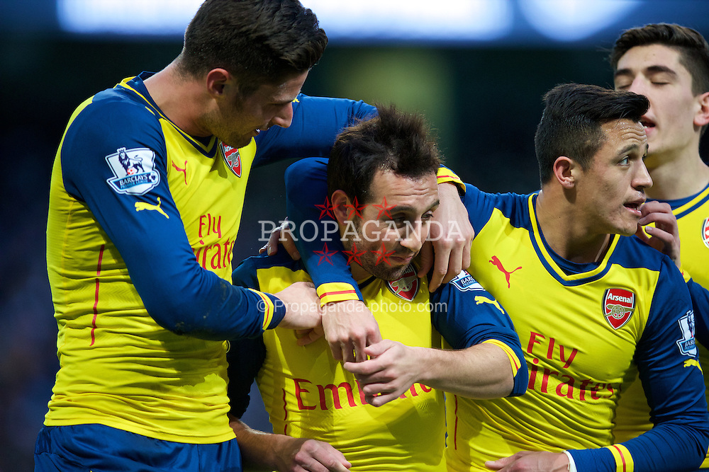 MANCHESTER, ENGLAND - Sunday, January 18, 2015: Arsenal's Santi Cazorla celebrates scoring the first goal against Manchester City from the penalty spot with team-mates during the Premier League match at the City of Manchester Stadium. (Pic by David Rawcliffe/Propaganda)