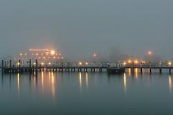 a cruise ship dockss on a foggy night in Vineyard Haven
