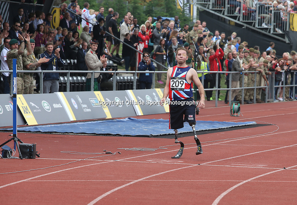 11 September 2014 - Invictus Games Day 1 - Ricky Furgusson of Team GB crosses the finishing line.<br /> <br /> Photo: Ryan Smyth/Offside